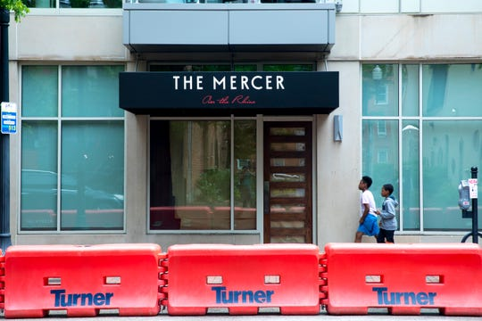 A view of a barricade which is set up on the street in front of The Mercer OTR on Thursday, May 14, 2020, in Over The Rhine to allow the restaurant to start serve outdoors on Friday, May 15.