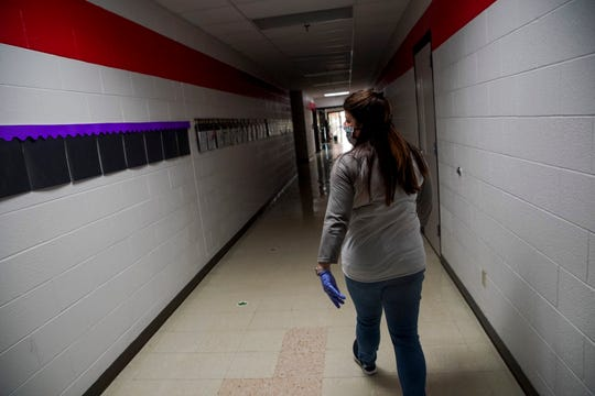 Ashlie Perry, principal, walks through the empty halls of her school at Minglewood Elementary School in Clarksville, Tenn., on Thursday, May 14, 2020.