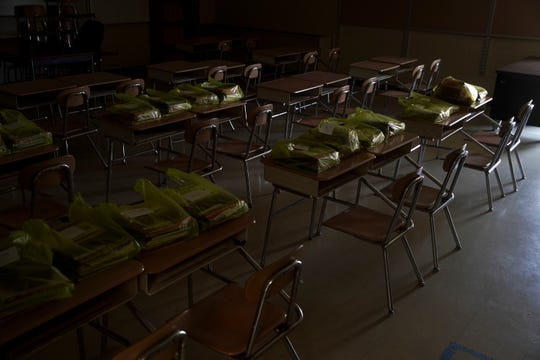 The empty classroom of a kindergarten class sits with students belonging's placed neatly atop desks and any decoration from the room gone as teachers clear out their rooms in the first time they were allowed in the school at Minglewood Elementary School in Clarksville, Tenn., on Thursday, May 14, 2020.