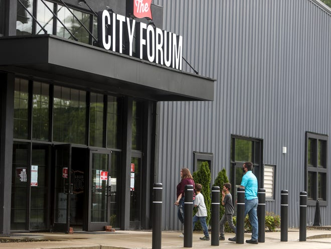 A family enters the front doors at The City Forum in Clarksville, Tenn., on Wednesday, May 13, 2020.