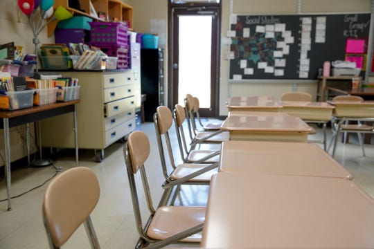 Empty desks and a classroom being cleared of belongings is all fourth grade teacher Katie Worsham has to work with at Minglewood Elementary School in Clarksville, Tenn., on Thursday, May 14, 2020.