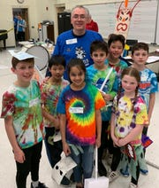 (Left to right): Franklin Elementary School students Devan Regas (grade 5), Takato Kaneda (grade 3), Siya Singla (grade 3), Luca Giaccobe (grade 3), Alex Giangone (grade 5), Lexie Twilley (grade 3), and Ben Britain (grade 5), pictured here with coach Andrea Giangone, placed second in the regional Odyssey of the Mind competition in March.