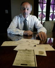 Fred Sbrilli shows one of the Victory Mail he received from his uncle Jospeh Ducceschi during World War II. Ducceschi was killed on D-Day on the beach at Normandy.