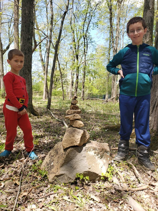 Eli and Andrew Stillmann built a rock cairn in the DIY club.