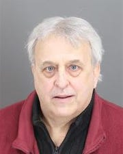 James Dennis, 63, of Harper Woods is shown in a booking photo. (Harper Woods Department of Public Safety)