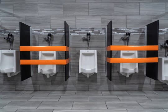Sinks and urinals are blocked off to make sure of social distancing for employees during an open house tour for workers as employees learn about the new precautions set in place as they prepare to return to work at Lear Corporation in Flint on Thursday, May 14, 2020.