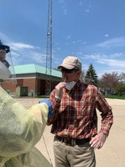Grosse Ile Township Supervisor Brian Loftus gets tested for coronavirus as part of a community-wide initiative to test at least half of the people who live on the island for a community-wide study.