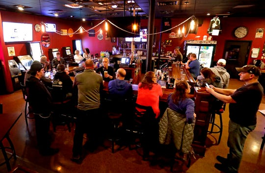 The Dairyland Brew Pub opens to patrons following the Wisconsin Supreme Court's decision to strike down Gov. Tony Evers' safer-at-home order amid the coronavirus pandemic, Wednesday, May 13, 2020, in Appleton, Wis.