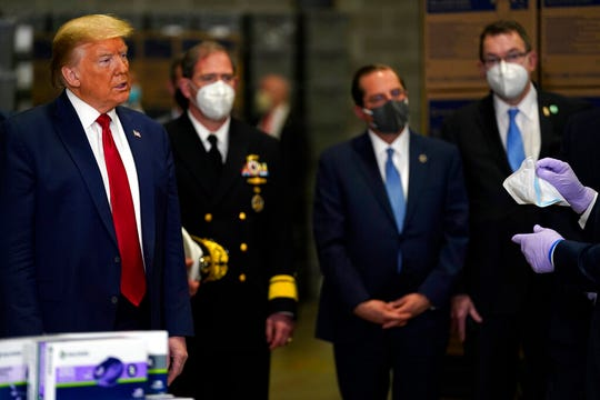 President Donald Trump participates in a tour of Owens & Minor Inc., a medical supply company, Thursday, May 14, 2020, in Allentown, Pa.