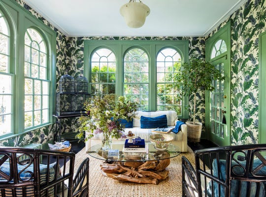 Erica Harrison's solarium in her Indian Village home is her favorite spot. The wallpaper is from House of Hackney. A vintage bird cage is in the corner.
