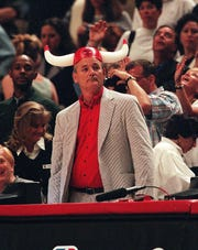 Bill Murray cheers for the Chicago Bulls as they play against the Indiana Pacers on May 31, 1998, at the United Center in Chicago, Ill.