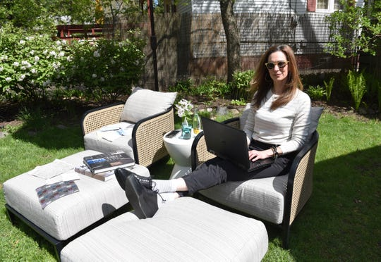"""Interior designer Jill Schumacher's favorite part of her Ferndale home is her backyard with two patio chairs. It's where she goes to answer emails or just hang out. She calls it """"my salvation."""""""