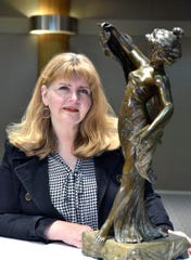 Ann Rasmussen with her metal statue.