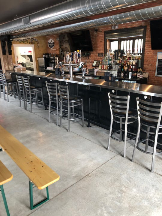 At 18 Hands Ale Haus, bar chairs are spaced out to limit capacity at the bar when the tavern reopens following a two-month shutdown from the coronavirus.