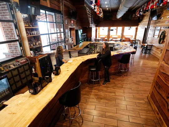 Bartender Kylee Gibson and owner Kari Koenigs get Top Shelf Bar and Grill ready to open Thursday, May 14, 2020 in Fond du Lac, Wis. Koenigs started preparing to open the day after hearing the Wisconsin Supreme Court's decision to strike down Governor Tony Evers extension to the safer at home order which closed many Wisconsin businesses. Koenigs still plans to have patrons practice social distancing by spacing out bar stools and not seating every table.