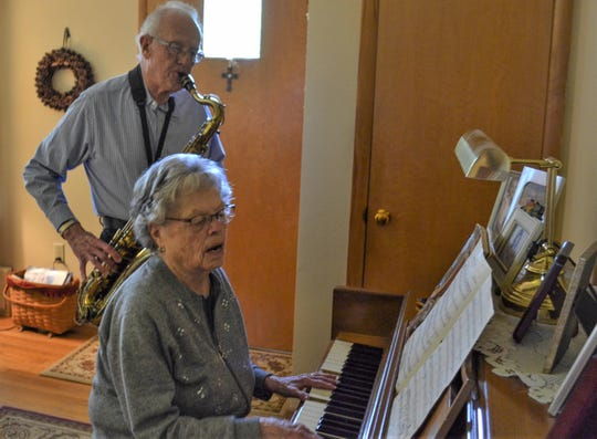 Music has been a shared passion for Walt and Evelyn Binger through 65 years of marriage. Here, they play sax and organ in their Vickery home. All four of their children and four of their grandchildren share their musical talent.