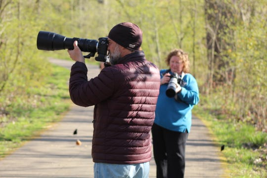 Birding enthusiasts came out with their cameras to Sheldon Marsh State Nature Preserve Wednesday evening, as they tried to capture photos of migratory birds making their annual trek through Northwest Ohio.