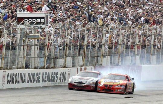 Ricky Craven, right, crosses the finish ahead of Kurt Busch to win the NASCAR Carolina Dodge Dealers 400 Sunday, March 16, 2003, at Darlington Raceway in Darlington, S.C.