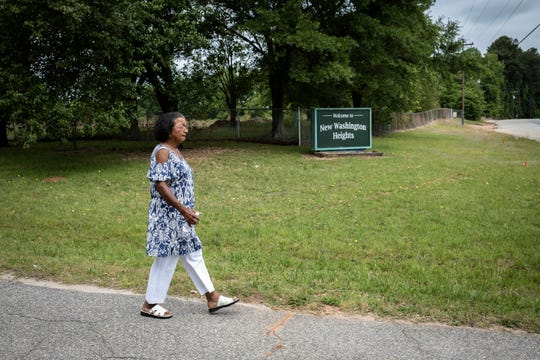 Charity Jones, 77, walks around the perimeter of the site of the former Washington High School in the New Washington Heights neighborhood of Greenville where Jones lives, Thursday, May 14, 2020.