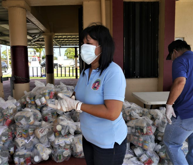 Barrigada Mayor June U. Blas takes a break during the food distribution with lots of remaining supplies during the Need to Feed event in Barrigada in this May 14 file photo.