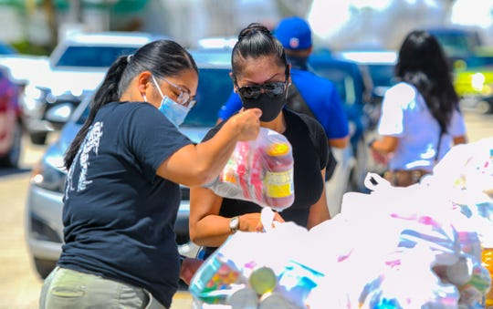 There have been numerous food distributions on Guam in the course of the COVID-19 pandemic. Pre-bagged packages of assorted food items were distributed by sponsors and volunteers during the Feed the Need drive-thru food distribution at the Yigo gymnasium on Thursday, May 14, 2020.
