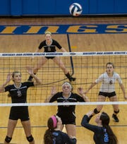 Henderson County's Hannah Watkins (3) Hannah Hobby (19), Cayce Chaykowsky (6) and Jailyn Brantley (8) are prepared to return Southwestern's shot during the state quarterfinals against Southwestern in the 2015 Kentucky High School girls volleyball championship in Louisville, Ky.
