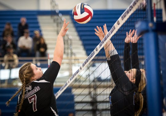 Henderson County's Libby Dockemeyer (7) takes it to the net against Southwestern's Lauren Whittis (14) during the 2015 state quarterfinals in Louisville.