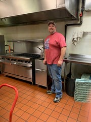 Captain Benny Carringer of the Salvation Army in Henderson stands beside the new six-burner gas range and new industrial fryer that the Henderson Lions Club purchased for the kitchen at the Center of Hope at 1213 Washington St. The purchases are among $40,000 allocated by the club to assist organizations in Henderson that are aiding people impacted by the COVID-19 pandemic.