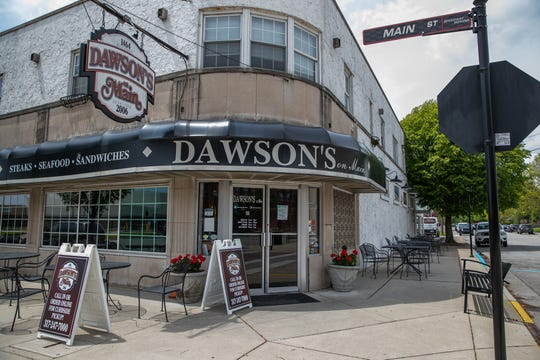 "Dawson's on Main sits empty amid the coronavirus pandemic in Speedway, Ind., on Thursday, May 14, 2020. ""It's a huge hit for everyone, it's kind of our Super Bowl,"" said owner Chris Hill about not having the Indianapolis 500 in May. ""It affects everything in Speedway. Hopefully we'll have it in August but it's kind of a moving target right now. That's the biggest frustration, it's the big unknown."""