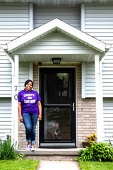 North Liberty Councilor RaQuishia Harrington poses for a photo with her dog Deuce, Wednesday, May 13, 2020, in North Liberty, Iowa.