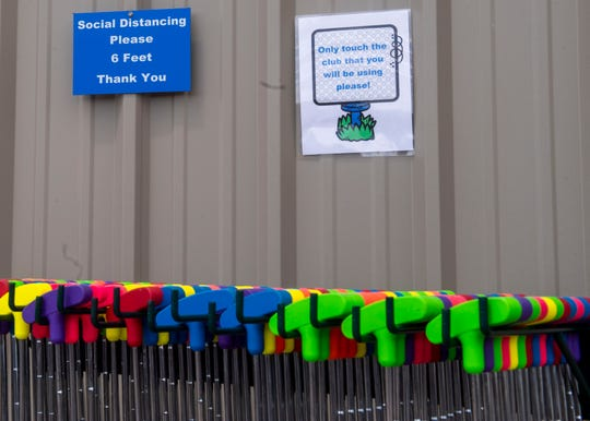 Signs are placed at Fun Zone Jumpers' 3 Rivers Mini Golf course to remind customers to practice social distancing Friday, May 15, 2020.