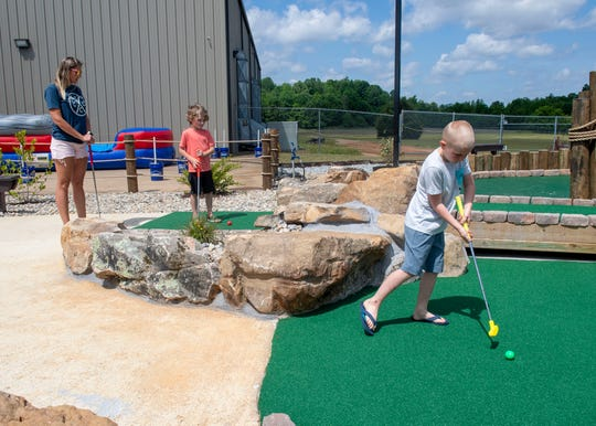 Julie Cartwright brings her children and their friends to Fun Zone Jumpers' 3 Rivers Mini Golf course in Jackson, Tenn., on Friday, May 15, 2020.