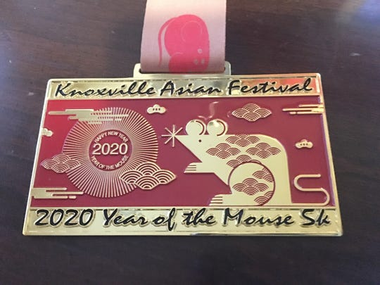 Participants who register for the 2nd Annual Knoxville Asian Festival Year of the Mouse 5K & 1 Mile Virtual Run by July 19 will receive a T-shirt and this medal. Feb. 9, 2020.