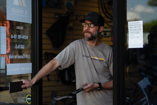 Luke Grieve, owner of Fountain City Pedaler on Central stands in the doorway of his shop before getting back to work repairing customers' bikes in North Knoxville, Thursday, May 14, 2020. Bike shops across Knoxville have seen an increase in demand for bikes and bike repairs during the coronavirus pandemic.