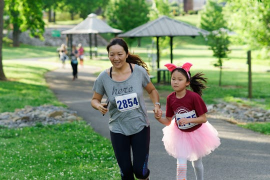 Participants in this year's 2nd Annual Knoxville Asian Festival Year of the Mouse 5K & 1 Mile Virtual Run are encouraged to smile, wearing costumes and submit pictures, just like these runners from last year's race! May 4, 2019.