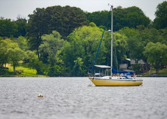 A sailboat floats in Fort Loudoun Lake at The Cove at Concord Park in Knoxville on Thursday, May 14, 2020.