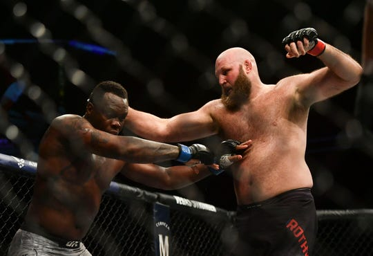 May 13, 2020; Jacksonville, Florida, USA; Ben Rothwell (red gloves) fights Ovince Saint Preux (blue gloves) during UFC Fight Night at VyStar Veterans Memorial Arena. Mandatory Credit: Jasen Vinlove-USA TODAY Sports