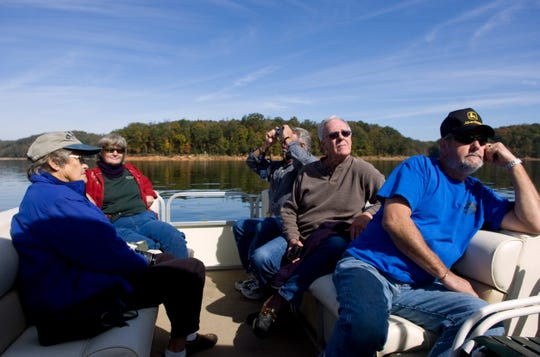 From left, Lucy Scanlan, Joanne Mitchell, Art Blank, Mel Harrington, and Bobby Mitchell admire the scenery of Norris Lake on Wednesday, Oct 21, 2009 during a boat tour that showcases the fall colors.  Norris Dam State Park is hosting Fall Color Boat Trips, a tour of Norris lake by boat that departs from Lighthouse Marina from Oct. 17, 2009 through Oct. 31, 2009.