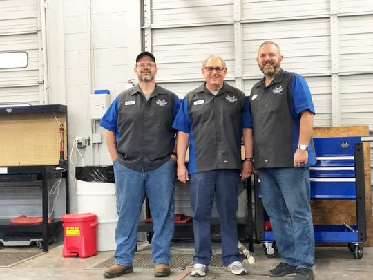 B.K. Hardin, owner of DIY Garage Knox, pictured right with Steve Richards, left, and Vic Howard. Certified mechanics will be available for advice and to take cars on and off the lift.