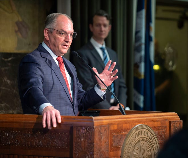 Gov. John Bel Edwards speaks Monday, May 11, 2020, at his media briefing on the state's COVID-19 response at the State Capitol in Baton Rouge, La., announcing that his stay-at-home directive will end with the Phase 1 reopening of the state on Friday, May 15. Dr. Alex Billioux, M.D., right, assistant secretary of health for the La. Dept. of Health's Office of Public Health, looks on. (Travis Spradling/The Advocate via AP, Pool)