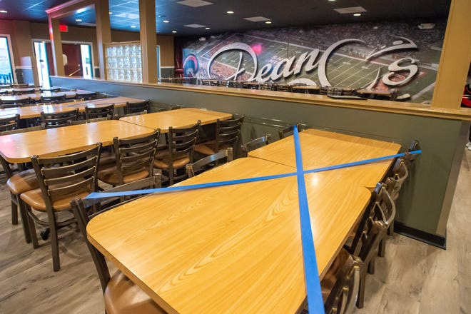 Deano's in Lafayette takes steps to limit the number of customers in the restaurant during the pandemic.
