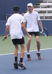 Lexington's Benton Drake, facing camera, and Blake Webster celebrate winning a point in Division II doubles during last year's state tennis tournament in Mason, Ohio. They got to play this first round match on center court at the Lindner Family Tennis Center, home to the Western & Southern Open pro tournament every August.