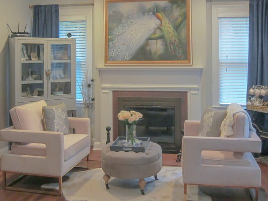 The living room is filled with an inviting mix of family heirlooms and contemporary furnishings.