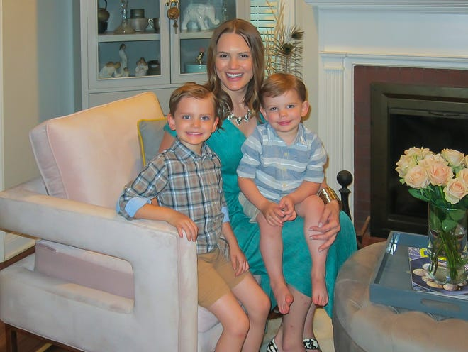 Alexandra Rushing and her two sons, Jack, left, and James, love their new home.