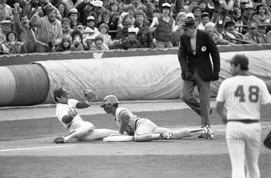 The Cardinals' Lonnie Smith was thrown out at third base by Brewer catcher Ted Simmons in the first inning of Game 5 of the 1982 World Series on Oct. 18, 1982.