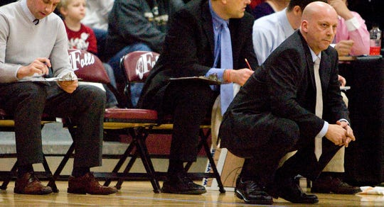 Waukesha West Boys Varsity Basketball Coach Dave Schultz looks on from the sidelines during a regional final in 2012.