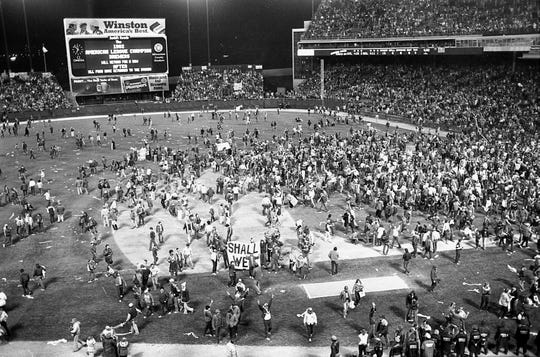 Fans took over the field at County Stadium Sunday after the Milwaukee Brewers won the fifth game of the World Series on Oct. 18, 1982.
