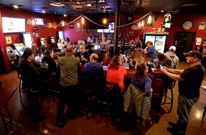 The Dairyland Brew Pub in Appleton opens to patrons following the Wisconsin Supreme Court's decision to strike down Gov. Tony Evers' safer-at-home order on Wednesday.
