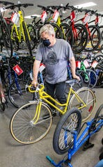 John Jensen, owner of Johnson's Cycle & Fitness in Wauwatosa, organizes his inventory on May 14, 2020. The business, which caters to all levels of rider and budget, has seen a tremendous increase in both sales and service due to the coronavirus pandemic.