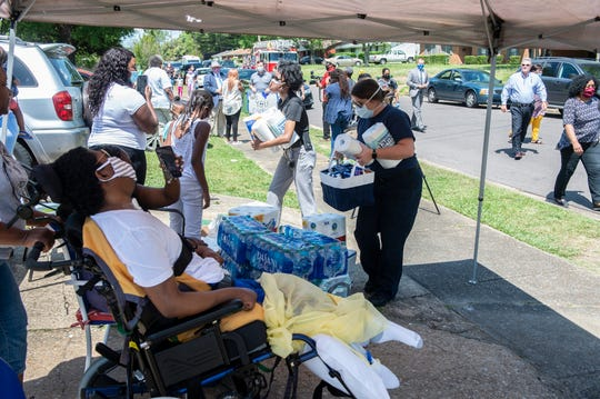MPD officer Carlos Taylor is joined by family and friends during a car parade in his honor in Montgomery, Ala., on Thursday, May 14, 2020. Taylor was injured in a crash while on duty in 2017.